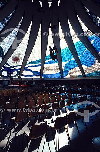 Interior da Catedral de Brasília (1) com vitrais de Marianne Peretti e anjos suspensos de Alfredo Ceschiatti - Esplanada dos Ministérios - Brasília (2) - DF - Brasil(1) A Catedral é Patrimônio Histórico Nacional desde 13-08-85.(2) A cidade de Brasília é Patrimônio Mundial pela UNESCO desde 11-12-1987.  - Brasília - Distrito Federal - Brasil