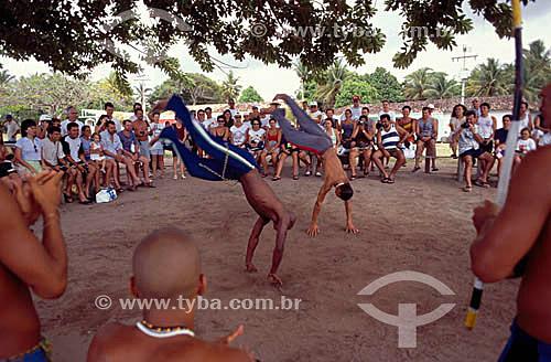 Pessoas assistindo a roda de capoeira em Porto Seguro  - BA - Brasil - Data: 2005  A área denominada Costa do Descobrimento (Reserva da Mata Atlântica) é Patrimônio Mundial pela UNESCO desde 01-12-1999 e nela estão localizadas 23 áreas de proteção ambiental na Bahia (incluindo Porto Seguro e Trancoso).