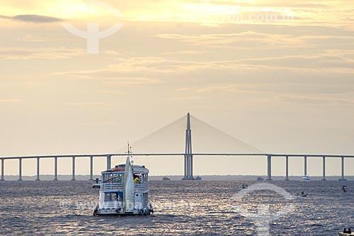 Pôr do sol no Rio Negro com a Ponte Rio Negro (2011) ao fundo  - Manaus - Amazonas (AM) - Brasil