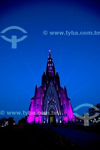 Vista da Paróquia de Nossa Senhora de Lourdes - também conhecida como Catedral de Pedra - com iluminação especial durante o anoitecer  - Canela - Rio Grande do Sul (RS) - Brasil