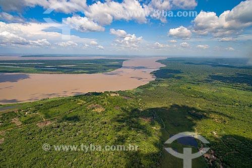 Foto aérea da Floresta Amazônica com trecho do Rio Amazonas  - Pará (PA) - Brasil