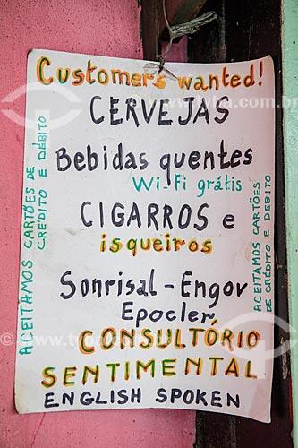 Detalhe de cartaz informando a venda de bebidas, cigarros, remédios e consultório sentimental na Barraca Já Disse - Centro Luiz Gonzaga de Tradições Nordestinas  - Rio de Janeiro - Rio de Janeiro (RJ) - Brasil