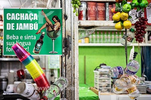 Detalhe de placa de publicidade com os dizeres: Cachaça de Jambu beba e sinta sua língua formigar! em bar no Centro Luiz Gonzaga de Tradições Nordestinas  - Rio de Janeiro - Rio de Janeiro (RJ) - Brasil