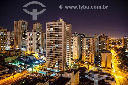 Foto feita com drone de prédios e casas do bairro Santa Cruz de José Jacques à noite  - Ribeirão Preto - São Paulo (SP) - Brasil