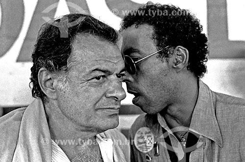 Assunto: Músicos Sérgio Ricardo e Jards Macale durante o comício por eleições Diretas / Local: São Paulo (SP) - Brasil / Data: 1984