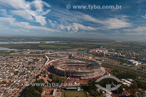 Assunto: Vista aérea da construção da Arena do Grêmio (2012) com o Delta do Jacuí ao fundo / Local: Humaitá - Porto Alegre - Rio Grande do Sul (RS) - Brasil / Data: 05/2012